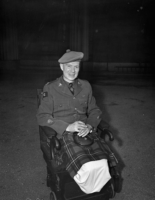 Major Frederick A. Tilston, Essex Scottish Regiment, at an investiture during which he received the Victoria Cross, Buckingham Palace, London, England, 22 June 1945.