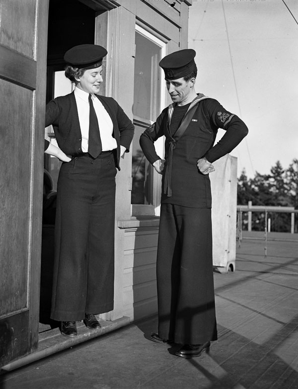Unidentified signalers of the Women's Royal Canadian Naval Service (W.R.C.N.S.) and Royal Canadian Navy (R.C.N.) comparing bellbottom trousers, Esquimalt, British Columbia, Canada, 22 February 1944.