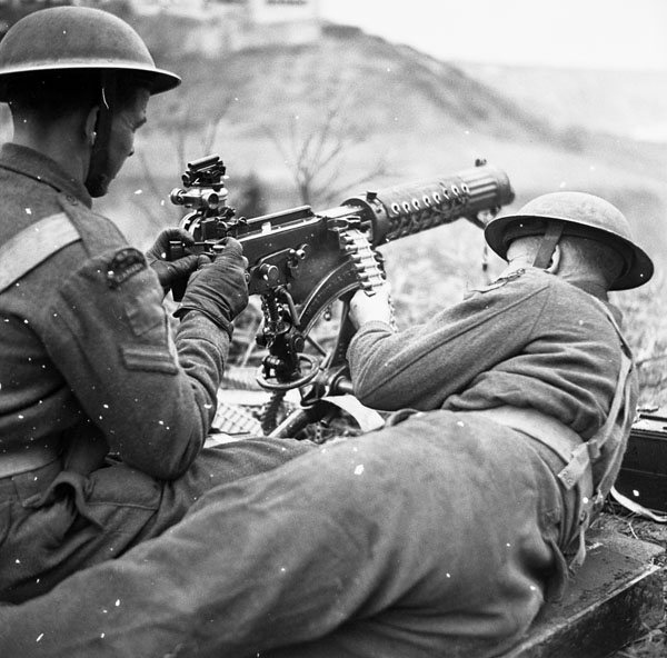 Unidentified personnel of the Saskatoon Light Infantry (M.G.) in a Universal Carrier equipped with a Vickers machine gun, Italy, 8 March 1944.