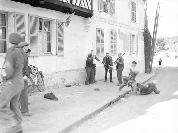 An elderly man attacking a collaborator, Bernay, France, 4 September 1944.