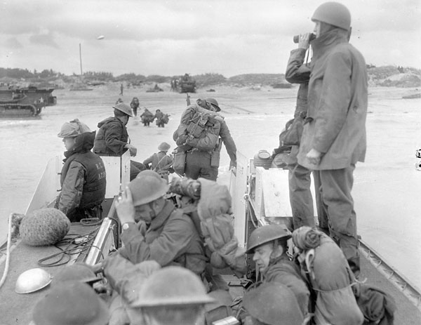Reinforcements going ashore from a Landing Craft Assault (LCA) from H.M.C.S. PRINCE HENRY off the Normandy bridgehead, June 1944.