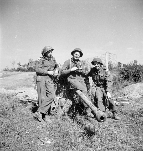 Infantrymen of the Queen's Own Rifles of Canada with their 6-pounder anti-tank gun, Carpiquet, France, 6 July 1944.