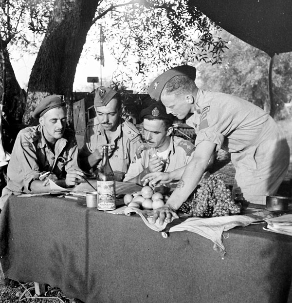 Unidentified officers of the Royal 22e Régiment reviewing plans during the advance on Busso, Italy, October 1943.