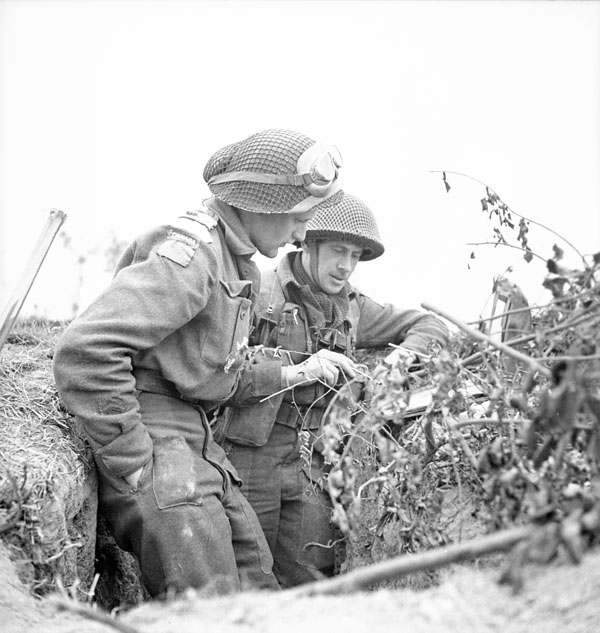 Officers of the Queen's Own Rifles of Canada discussing tactics, Carpiquet, France, 8 July 1944.