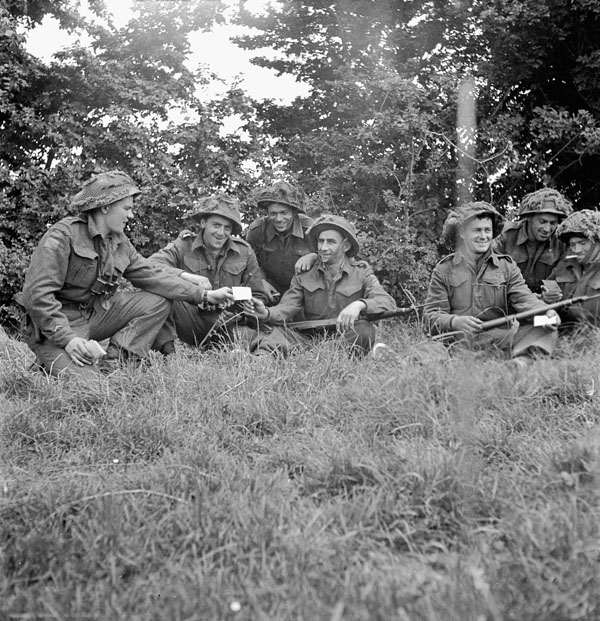 Infantrymen of an unidentified regiment of the 9th Canadian Infantry Brigade in the Normandy bridgehead, ca. 8-9 June 1944.