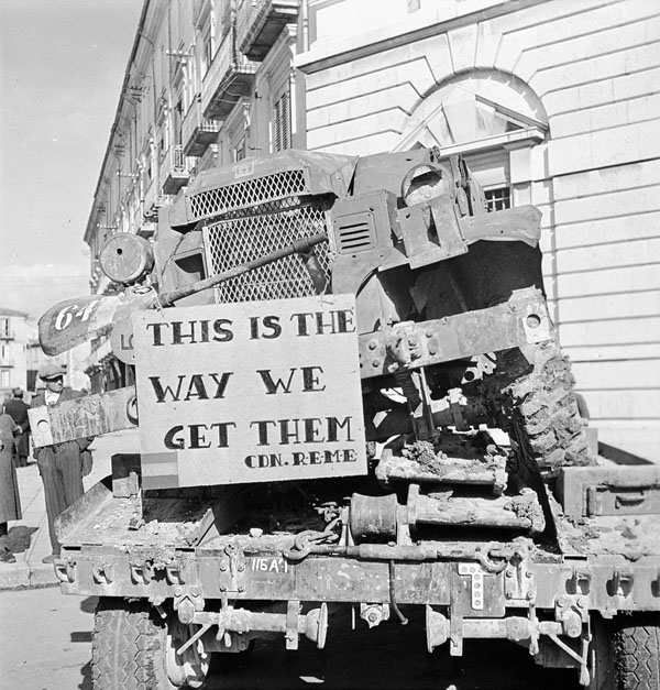 A Royal Canadian Electrical and Mechanical Engineers (R.C.E.M.E.)  display supporting the Fifth Victory Bond campaign, Campobasso, Italy, 27 October 1943.
