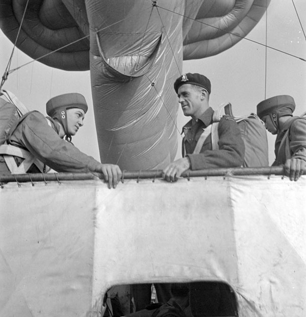Major P.R. Griffin (left) of the 1st Canadian Parachute Battalion preparing to jump from a static balloon, England, October 1943.