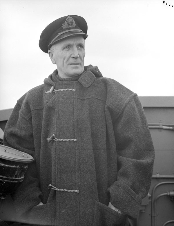 Lieutenant(E) John (Jock) Morrison, R.C.N.R., Engineer Officer, H.M.C.S. SWANSEA, at sea, ca. December 1943-January 1944.