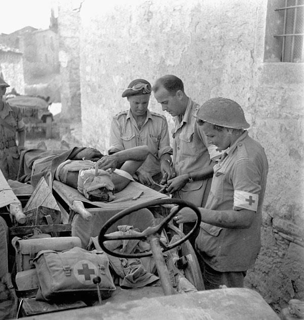 A wounded German officer, who was found by Lieutenants Alex Stirton and George Cooper, being evacuated to hospital, Carleto, Italy, 18 September 1943.