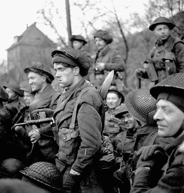 Infantrymen of the Royal Winnipeg Rifles in a Buffalo amphibious vehicle taking part in Operation VERITABLE en route from Niel to Keeken, Germany, 9 February 1945.