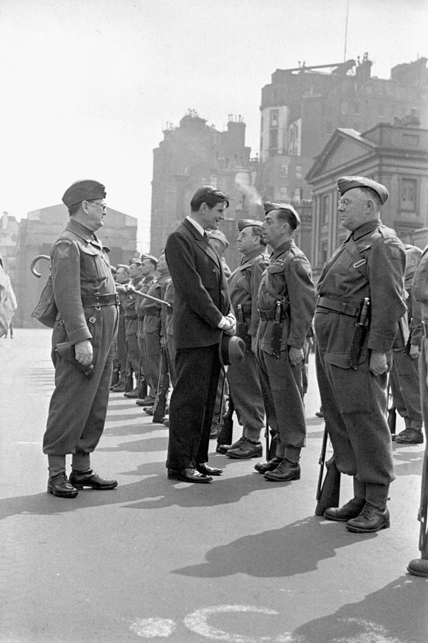 Hon. J.G. Winant, United States Ambassador to Great Britain, inspecting American and Canadian members of the Home Guard, Wellington Barracks, London, England, 4 July 1942.
