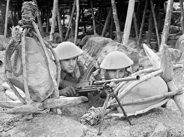 Infantrymen of the Lincoln and Welland Regiment  aiming their Bren guns during a battle drill exercise, St. John's, Newfoundland, May 1943.