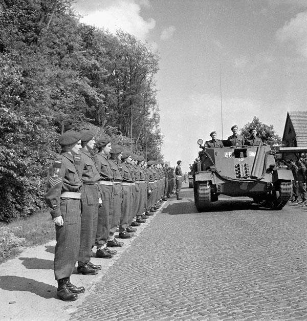 Self-propelled anti-tank guns of the 2nd Anti-Tank Regiment, Royal Canadian Artillery (R.C.A.), taking part in a parade marking the handing-in of the guns of the 2nd Canadian Infantry Division near Oldenburg, Germany, 15 May 1945.