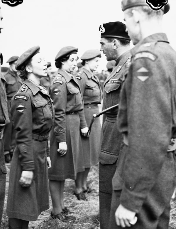 Lieutenant-General G.G. Simonds, General Officer Commanding 2 Canadian Corps, inspecting the personnel of No..2 Casualty Clearing Station, Royal Canadian Army Medical Corps (R.C.A.M.C.), Oldenburg, Germany, 2 June 1945.