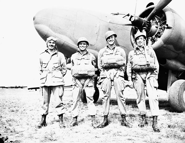 Paratroopers of the 1st Canadian Parachute Battalion in front of the Lockheed Lodestar aircraft 560