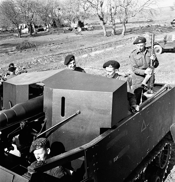 Personnel of the Royal Canadian Dragoons in a 75mm. halftrack gun carrier near Larino, Italy, 20 March 1944.