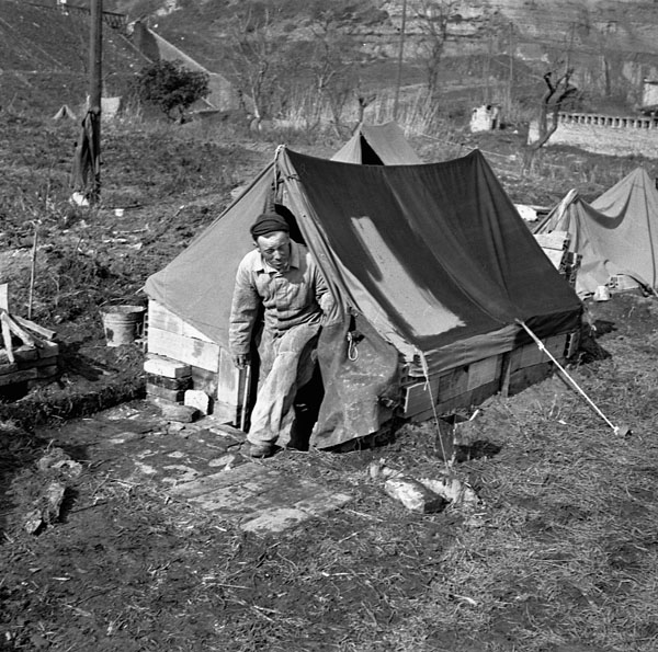 Private Albert Vincent, Royal Canadian Ordnance Corps (R.C.O.C.), emerges from his tent north of Ortona, Italy, 15 February 1944.