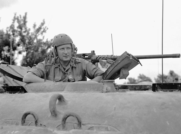 Major-General B.M. Hoffmeister, General Officer Commanding 5th Canadian Armoured Division, in the turret of the Sherman tank