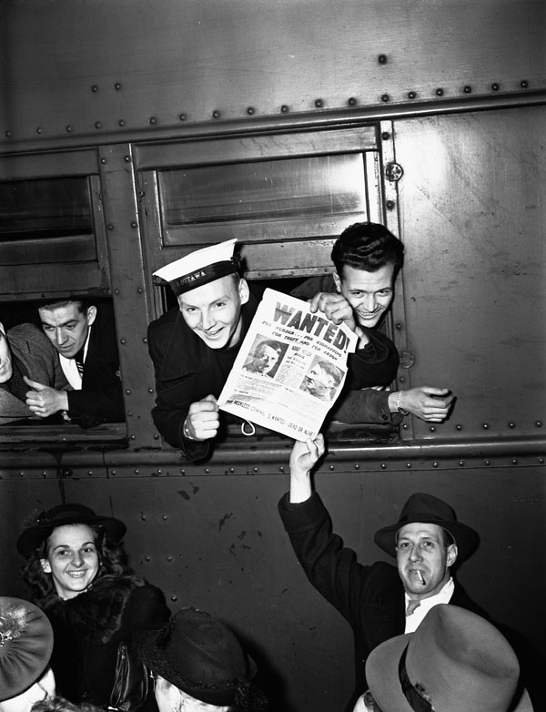 Unidentified members of the Royal Canadian Navy (R.C.N.) in a train leaving Union Station, Ottawa, Ontario, Canada, 19 November 1940.
