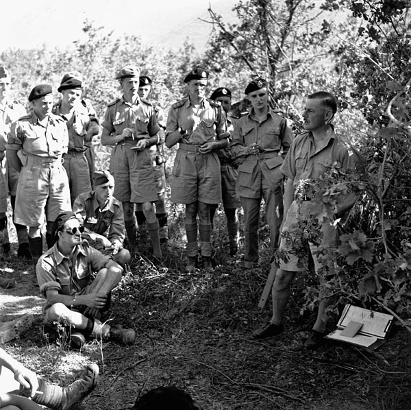 Brigadier Murphy, 1st Canadian Armoured Brigade, visiting the Forward Headquarters of the Calgary Regiment to make rush plans to cut off German paratroops withdrawing from Aquino, Italy, 23 May 1944.