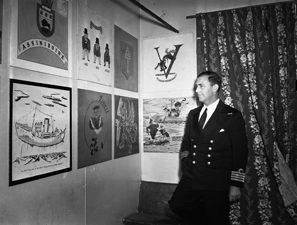 Captain E.R. Mainguy, Captain (D), Royal Canadian Navy (R.C.N.), in The Crowsnest, a club which he established for seagoing officers, St. John's, Newfoundland, September 1942.