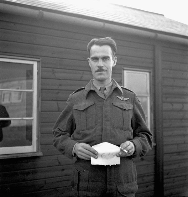An unidentified officer of the 1st Canadian Parachute Battalion posing for an identification photo, England, 1943.