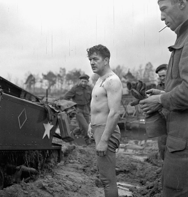 Sergeant Lyle D. Young, Royal Regiment of Canada, who helped salvage his Universal Carrier which fell off Molson's Bridge into the Twenthe Canal north of Almen, Netherlands, 6 April 1945.