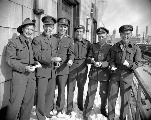 Six members of the Special Operations Executive (British Army), returning from duty in Burma and Southeast Asia aboard H.M.T. QUEEN ELIZABETH, New York, New York, United States, 20 February 1946.