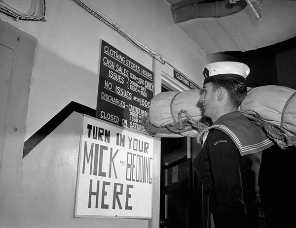 I.D. Lafontaine being discharged from the Royal Canadian Navy (R.C.N.), Ottawa, Ontario, Canada, 8 August 1945.