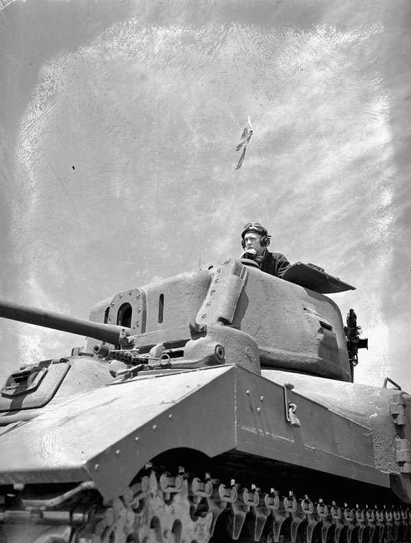 Unidentified crew commander in a Ram tank at A33 Canadian Armoured Corps Training Establishment, Camp Borden, Ontario, Canada, 7 July 1943.