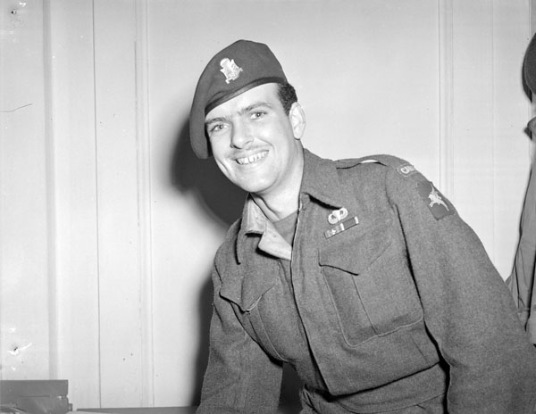 Private Derrick W. Haney, a former member of the disbanded First Special Service Force, who is awaiting repatriation to Canada. London, England, 5 June 1945.