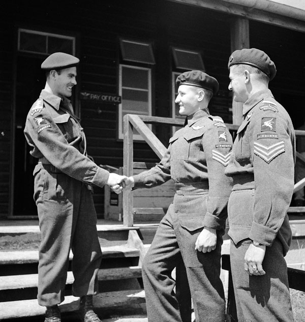 Two unidentified sergeants and a private of the 1st Canadian Parachute Battalion in front of Battalion Headquarters, Carter Barracks, Bulford, England, ca. May-June 1944.