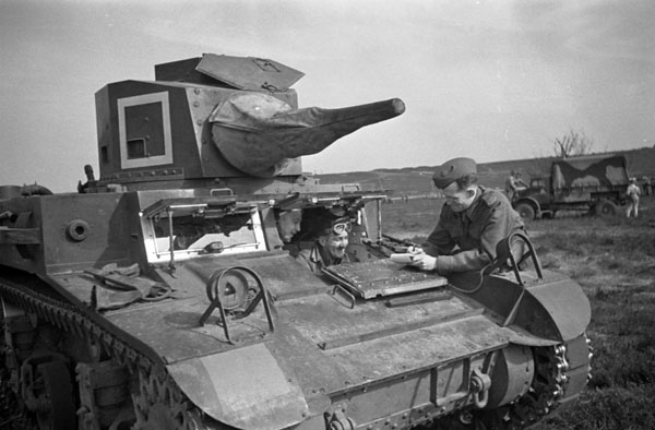 War correspondent Ross Munro of the Canadian Press and Lieutenant George Noble examining a General Lee tank, England, 27 March 1942.