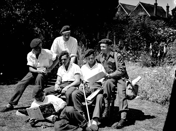 Injured paratroopers of the 1st Canadian Parachute Battalion recuperating at No.11 Canadian General Hospital, Royal Canadian Army Medical Corps (R.C.A.M.C.), Taplow, England, June 1944.
