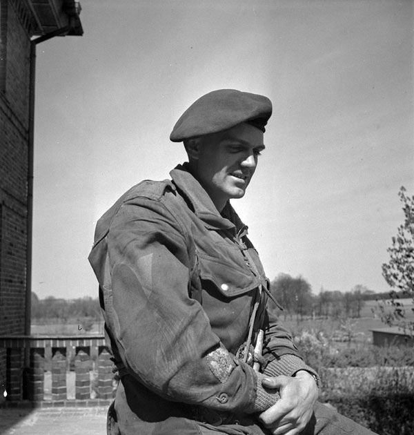 Regimental Sergeant-Major H.K. Duckett of the 1st Canadian Parachute Battalion pauses during the battalion's advance from Celle to Harstedt, Germany, 19 April 1945.