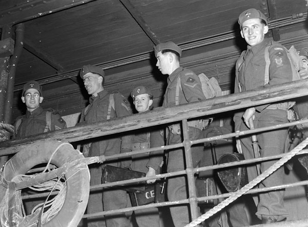 Unidentified personnel of the 13th Infantry Brigade Group disembarking from a United States transport returning from Operation COTTAGE, the attack on Kiska. British Columbia, Canada, ca. November 1943 - January 1944.