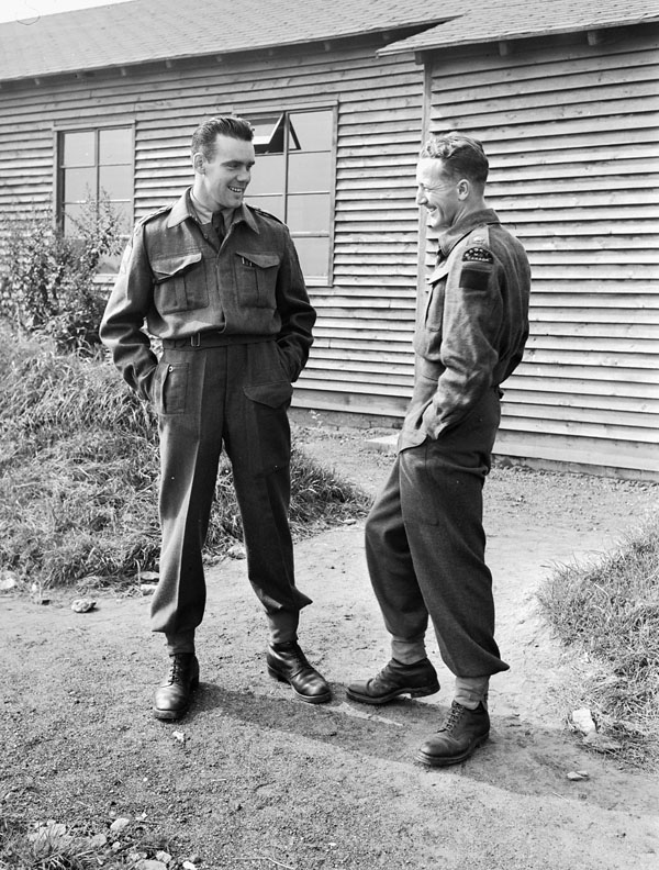 Major G.F.P. Bradbrooke (left) of The Saskatoon Light Infantry (M.G.), and Captain Jeff Nicklin of The Royal Winnipeg Rifles after their British parachute course at  the Royal Air Force Parachute Training School, Ringway, England, 12 September 1942.