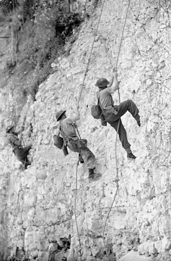Infantrymen of the 3rd Canadian Infantry Division scaling a cliff during an assault landing course, Seaford, England, 21 July 1942.