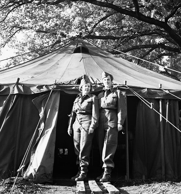 Nursing Sisters outside the operating room tent of No.2 Casualty Clearing Station, Royal Canadian Army Medical Corps (R.C.A.M.C.), England, November 1942.