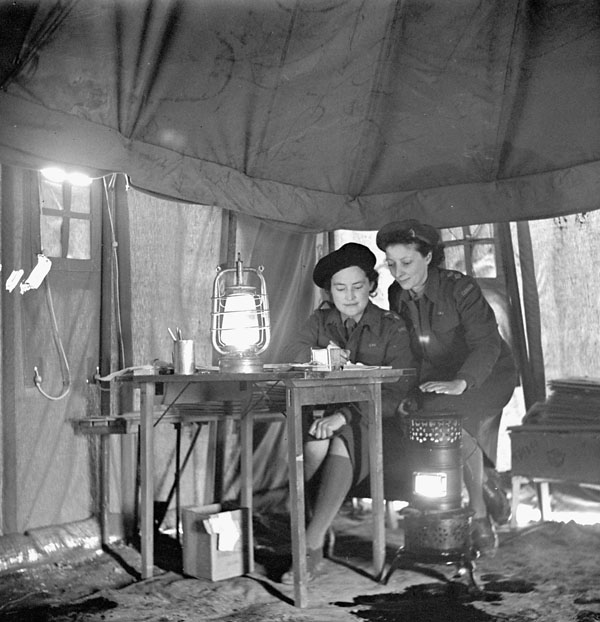 Nursing Sisters Eloise MacDiarmid and Frances Caddy on night duty, No.1 Canadian General Hospital, Royal Canadian Army Medical Corps (R.C.A.M.C.), Andria, Italy, February 1944.