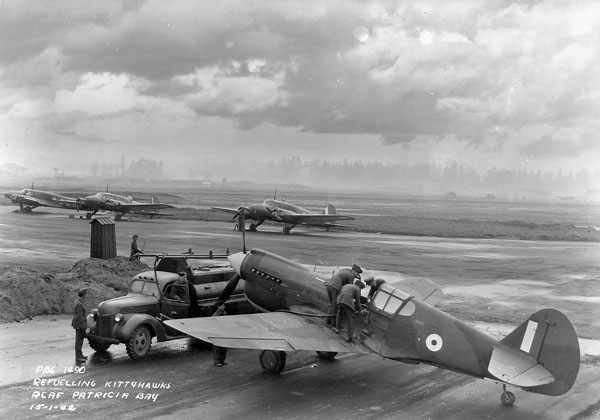 Groundcrew refuelling Curtiss Kittyhawk I aircraft of No.111(F) Squadron, Royal Canadian Air Force (R.C.A.F.), Patricia Bay, British Columbia, Canada, 15 January 1942.