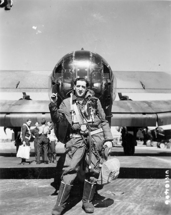 F/O Phil Marchildon, rear gunner, with Handley Page B.III aircraft HX290 BM:V of No. 433 (Porcupine) Squadron, R.C.A.F., Skipton-on-Swale, England, 1944.