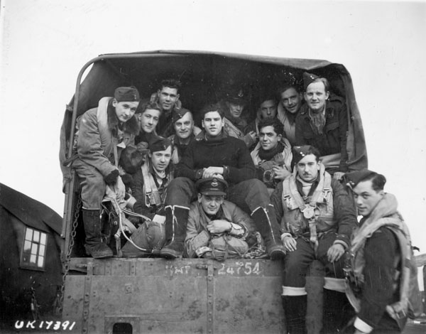 Aircrew of No. 433 (Porcupine) Squadron, RCAF, en route to their Handley Page Halifax B.III aircraft before taking off to raid Hagen, Germany.