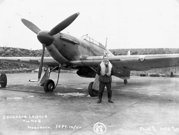S/L E.A. McNab, Commanding Officer, with a Hawker Hurricane I aircraft of No.1 (F) Squadron, R.C.A.F., Northolt, England, 12 September 1940.