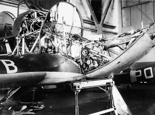 Maintenance crew in hangar with a Hawker Hurricane aircraft of No. 401 (Ram) Squadron, R.C.A.F., Digby, England, 18 March 1941.