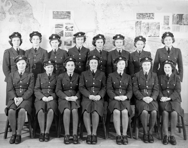 The timekeepers: personnel of the Women's Division, No. 2 Service Flying Training School, R.C.A.F., Uplands, Ontario, Canada, 1942.