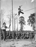 MIKAN 3387463 (Sports - 2nd Infantry Brigade) Exhibition Jump. Capt. E.B. Archibald, Y.M.C.A. August, 1916. Aug., 1916. [(Sports - 2nd Infantry Brigade) Exhibition Jump. Capt. E.B. Archibald, Y.M.C.A. August, 1916., Aug., 1916.]