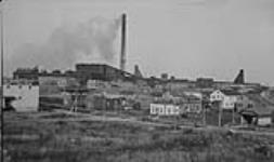 MIKAN 3373634 Noranda Smelter & Mill showing No. 3 & No. 4 shaft and part of town, Rouyn, P.Q. Oct. 1929 [Noranda Smelter & Mill showing No. 3 & No. 4 shaft and part of town, Rouyn, P.Q., Oct. 1929]
