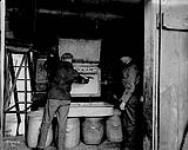 0 0 [Unloading a mixer. British Explosives Co. Ltd., Renfrew, Ont., c. 1914-1918]