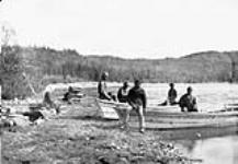 MIKAN 3194149 [First Nations crew at Cache Lake Camp]. Original title: Indian crews at Cache Lake Camp [graphic material] 16 July 1887. [[First Nations crew at Cache Lake Camp]. Original title: Indian crews at Cache Lake Camp [graphic material], 16 July 1887.]